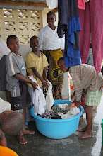 Photo: children and care workers are washing clothes