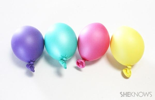 blow up 10  balloons to the size of a large egg