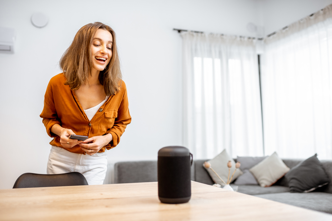 woman-using-voice-command-on-smart-device