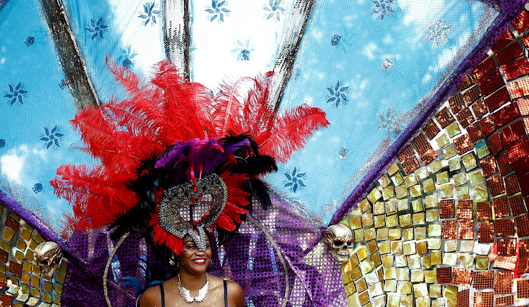 Revellers take part in the Notting Hill Carnival in London.