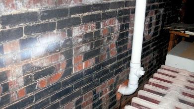 Photo: Former exterior wall advertising: BISER [?] MOTORS - WHITE TRUCKS