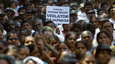 Photo: Indian Tamil activists attend a protest against Sri Lanka's Sinhalese-dominated government, which has been accused of abusing Tamils during the country's civil war, in Mumbai, India, Wednesday, March 20, 2013. The protesters demanded that India support the resolution that the United States proposes to introduce at the current United Nations Human Rights Council meeting urging a full accounting of what happened at the end of Sri Lanka's civil war. (AP Photo/Rafiq Maqbool)