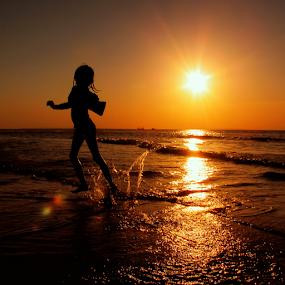 Dancing With Sunshine by Wahyu Jr. Abadi - Babies & Children Children Candids ( backlight, sunset, geghans, silhouettes, beach, sunrise, surabaya,  )