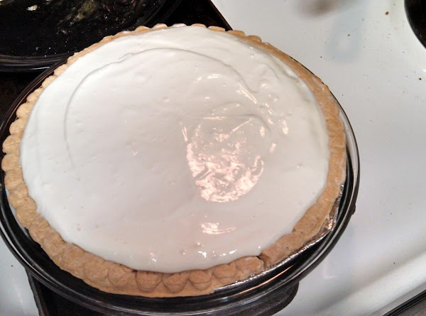 pour your cream cheese over the cooling blueberry pie. cover and smooth to edges. let...