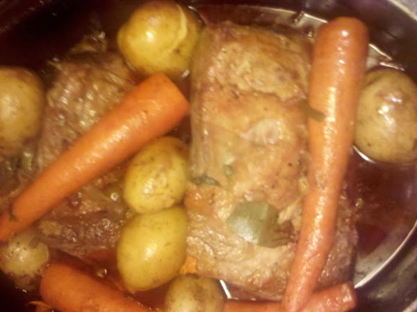 After the boil, transfer the roast pan in the oven and let it bake...