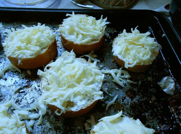 Spread softened cream cheese over top of bread slices, then top with grated cheese.