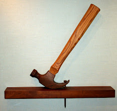 Photo: The joys of art, craftsmanship, and wood run throughout the house. This large, wall-size hammer is by Fredrick Wall.