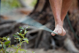 Photo: Man walking slackline while on a raft trip down the Middle Fork of the Salmon River, ID.