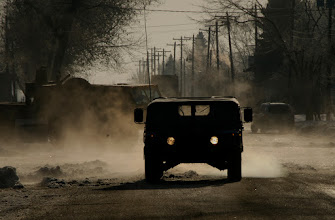 Photo: A Minnesota National Guard humvee patrols the streets of Moorhead, Minn. during Flood Fight 2009 on March 28.