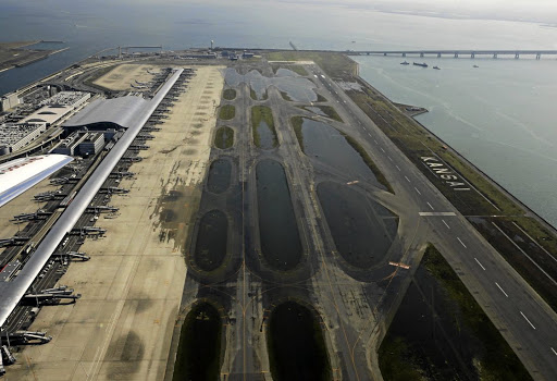 An aerial view shows a flooded runway at Kansai airport after Typhoon Jebi hit the area, in Izumisano, western Japan, on September 5 2018. Picture: KYODO VIA REUTERS