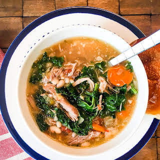 Slow Cooker Tuscan Soup with Pork, Beans, and Kale.