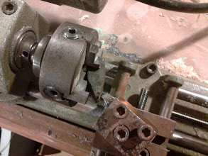 Photo: Trying to use the 4 jaw chuck on the lathe to mill one of the game piece 'roof' faces.