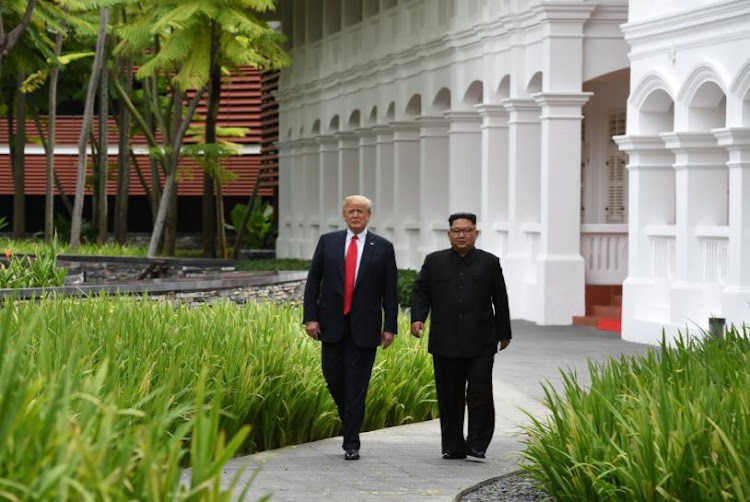 U.S. President Donald Trump and North Korean leader Kim Jong Un walk together outside the Capella Hotel on Sentosa island in Singapore. REUTERS/Jonathan Ernst TPX IMAGES OF THE DAY