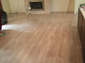 Photo: laminated flooring installation light color.