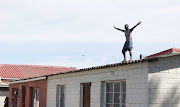 Residents of Langa, Cape Town, taunted police as they defied the first day of the national lockdown on Friday. Police said they were 'being nice' on Friday but would soon get tough and start arresting people.