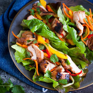 Grilled Chicken Lettuce Wraps with Carrot, Cucumber and Mango Slaw.