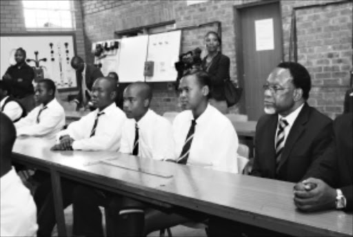 TOP OF THE CLASS: Deputy President Khalema Motlanthe sits in on a science lesson at Soshanguve