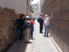 "Photo: Coricancha on the right. Different type of megalithic masonry on the left.  Famous ""rogue archeologist"" and ancient mysteries publisher David Hatcher Childress talks to our travel group. In German language his title would be ""Urgestein David"" with the idiom Urgestein meaning ""famous representative"" and literally ""prehistoric rock"" :-)  The tour was organized and lead by Brien Foerster and Hugh Newman: http://megalithomania.co.uk/tours.html ,  http://hiddenincatours.com"