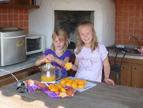 Photo: The girls juicing oranges first morning