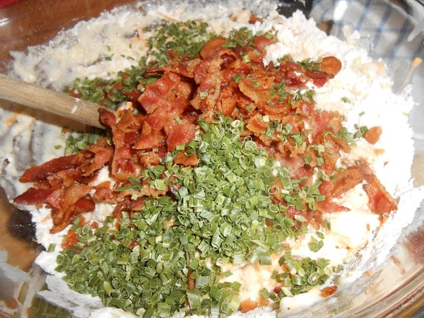 Add egg mixture to the flour mixture along with the bacon, cheese and chives;...