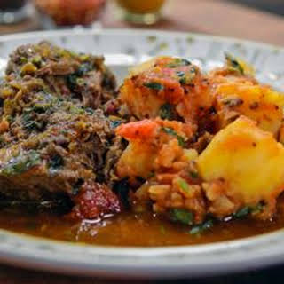 Indian-spiced lamb shoulder with Bombay potatoes.