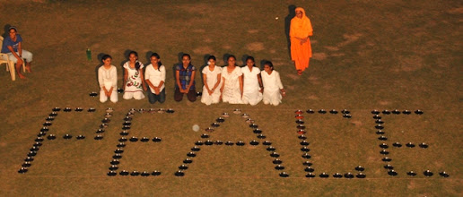 Photo: Formation of word 'PEACE' with plates by Atharvaved girls