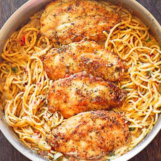 Chicken Pasta in Creamy White Wine Parmesan Cheese Sauce.