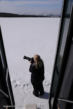 Photo: Cindy Nafpliotls shoots from outside the door of our snow coach. Yellowstone National Par, Wyoming.