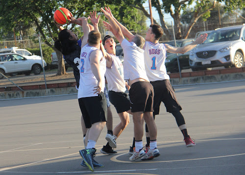 Boars' Jerou Tecson shoots, as Tune Squad's Mitch Nairn, Zac Lauritsen, Kevin Lawty and Jake Brayshaw all try to block on Wednesday afternoon in the sides' men's comp semi-final.
