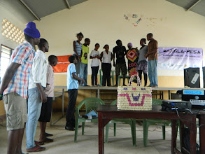 Photo: Drama (Performed by Alpha and Omega youth group) - explaining Bangla-Pesa. (the Bangla-Pesa basket can be seen in front of them)http://koru.or.ke