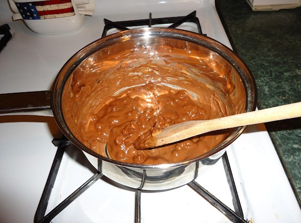 To prepare the first layer, in a saucepan over low heat, add milk choc....