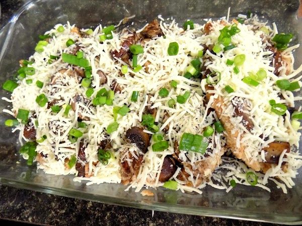 Spread mushrooms evenly over chicken and pour sauce from skillet. Pour sauce over chicken....
