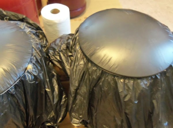 Place black plastic trash bag on top of pail & secure with rubber band...