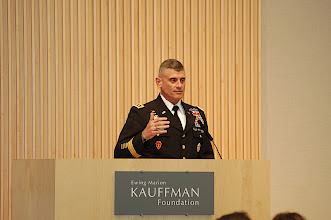 Photo: Lt. Gen. Robert Caslen, Commander, Fort Leavenworth, and Commandant of CGSC at Fort Leavenworth, addresses summit attendees on his experiences as an Army division commander in Iraq who had to deal with economic issues and planning.