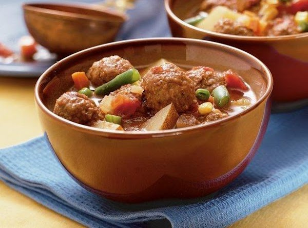 Spray Crockpot with cooking spray, brown meatballs then drain on paper towel, add next...