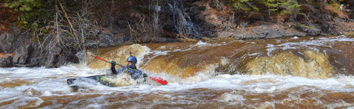 Photo: An unidentified kayaker runs one of the rapids just upstream of Lester Park before the start of the Lester River Race on Saturday, April 26.