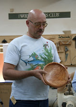 Photo: Don Van Ryk shows his deep cherry platter.