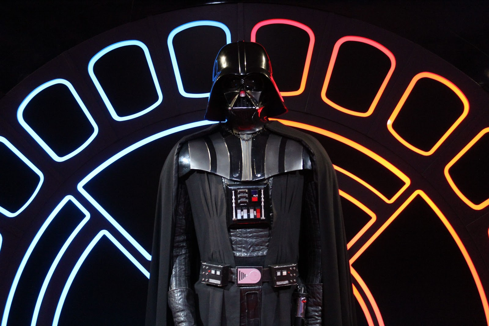 Model of Darth Vader, with light and dark imagery behind him