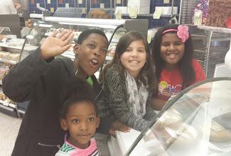 Photo: picking up Kaleya's cake