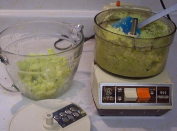 Stir in the shredded and drained zucchini.  Into the sugar, egg mixture.