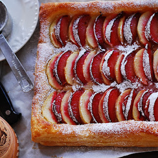 Plum And Apple Tart On Puff Pastry.