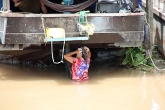 Photo: Year 2 Day 32 - Washing Her Hair in the River Under Her House Boat