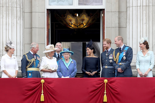 Members of The Royal Family watch the RAF flypast on the balcony of Buckingham Palace