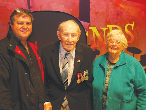 AIPP photographer, Digby Brown, with World War Two veteran Colin Busby and his wife, Alison.