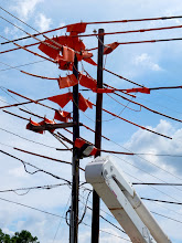 Photo: Electric Art? A bunch of guys were wrapping these power lines on Sunday.