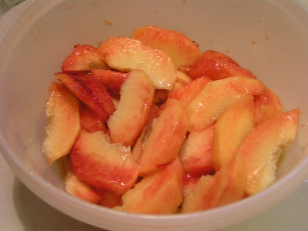 Slice peaches, removing any briused or dark spot and of course the pits. ...