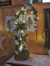 Photo: Een bijzonder kerststukje van Buurvrouw Margo