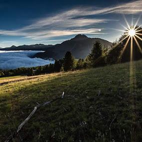 sunrise over the clouds  by Lorenzo Moggi - Landscapes Sunsets & Sunrises ( clouds, mountain, sunrise, sun )