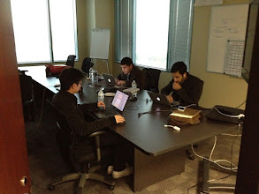 Photo: Hacking away in the conference room.
