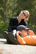 Photo: Happy family sitting on ground while camping.
